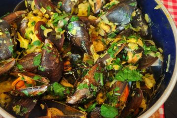 mussels in coconut curry in a large pot